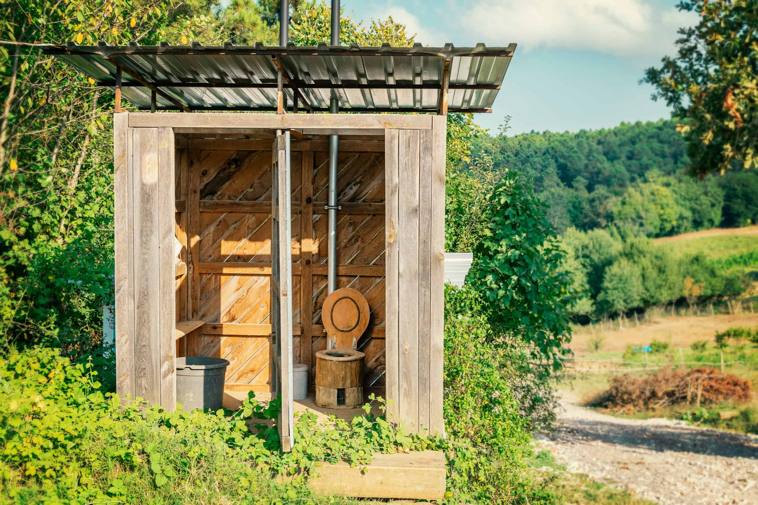 Wooden composting toilet on eco-farm