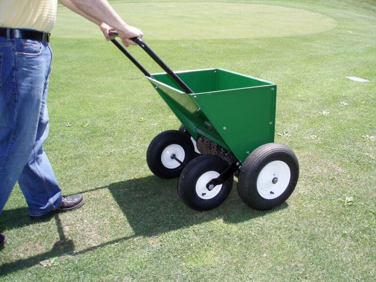 compost spreader from earth and turf