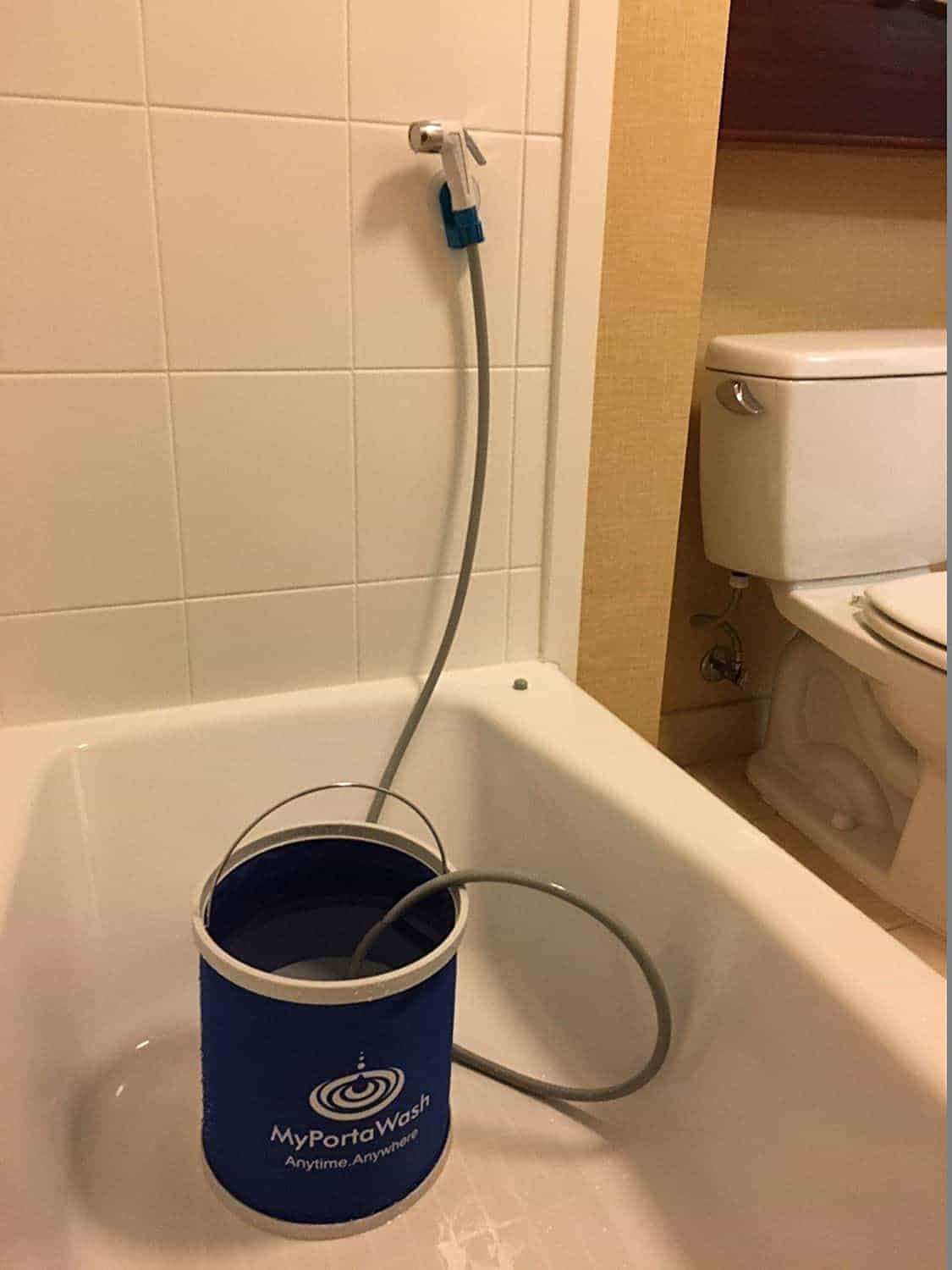 bidet hose sitting in a bucket of water