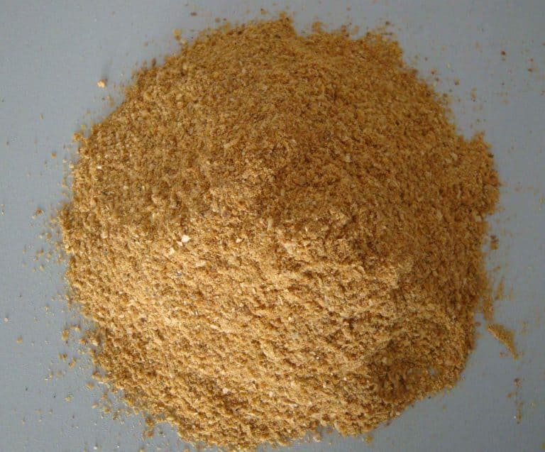 pile corn gluten meal which can be used to get rid of a lawn full of weeds